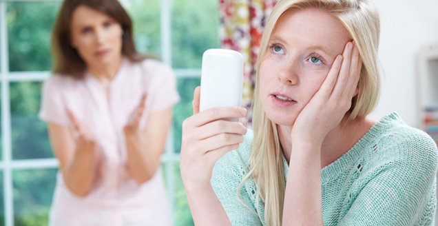 Mother Arguing With Teenage Daughter Over Use Of Mobile Phone