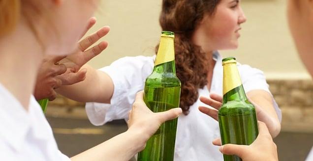 Teenage girl refusing alcohol