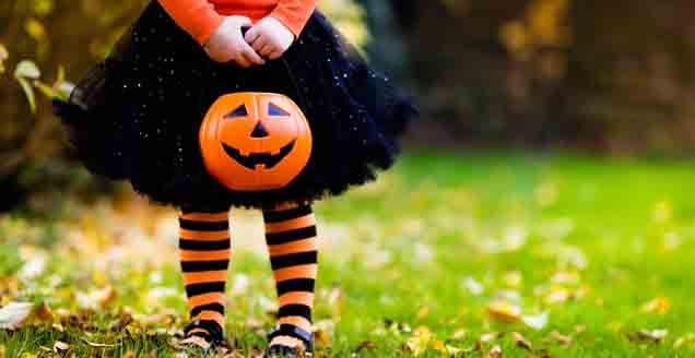 Little girl in trick or treat costume