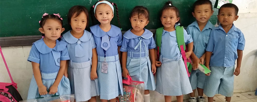 Children being educated by The Freedom Project