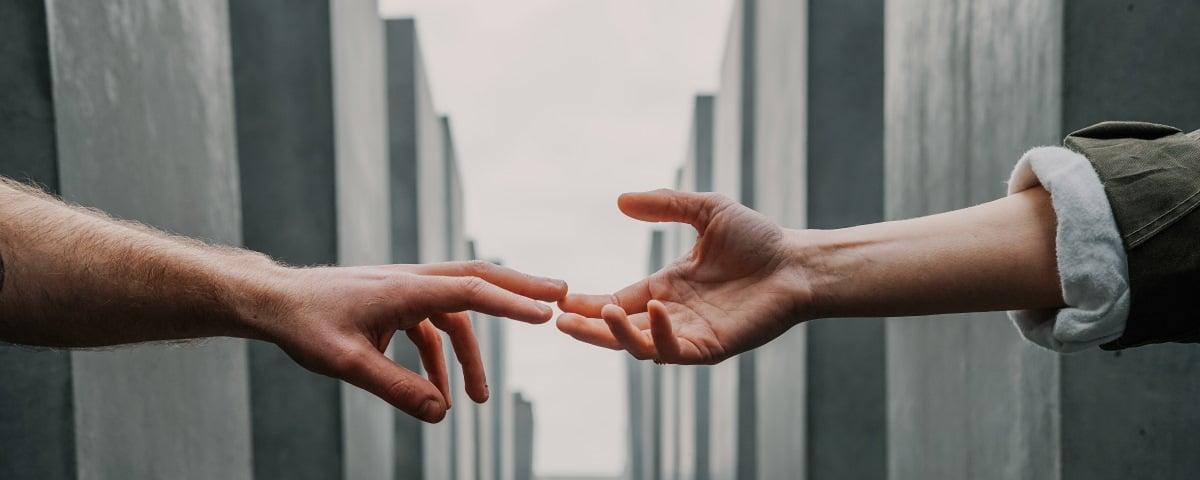 Hands Reaching across a divide