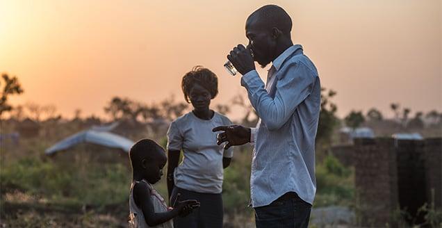 Malis Justin, 30, photographed outside his new home in BidiBidi camp, northern Uganda.