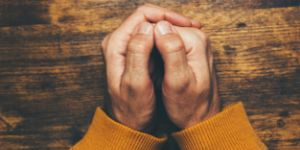 Man praying hands clasped (1)