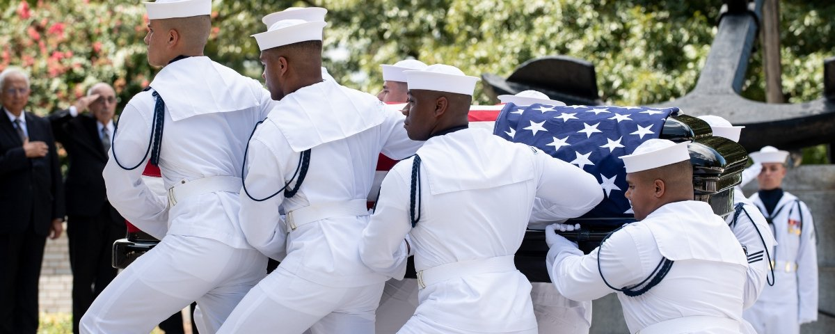 180902-N-OI810-169. ANNAPOLIS, Md. (Sept. 2, 2018) Navy Body Bearers move the casket of the late Sen. John McCain from his processional hearse to the United States Naval Academy Chapel, Sept. 2, 2018. John Sidney McCain, III graduated from the United States Naval Academy in 1958. He was a pilot in the United States Navy from 1958 until 1981. From 1967 to 1973 he was a prisoner of war in Vietnam. He received numerous awards, including the Silver Star, Legion of Merit, Purple Heart, and Distinguished Flying Cross. (U.S. Navy photo by Mass Communication Specialist 2nd Class Nathan Burke/Released)