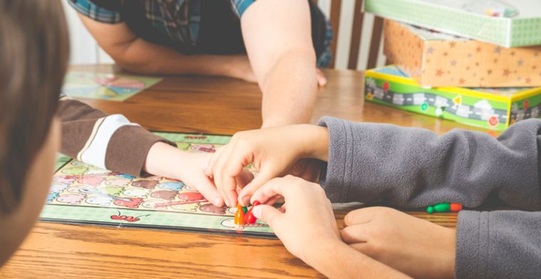 Kids play boardgame