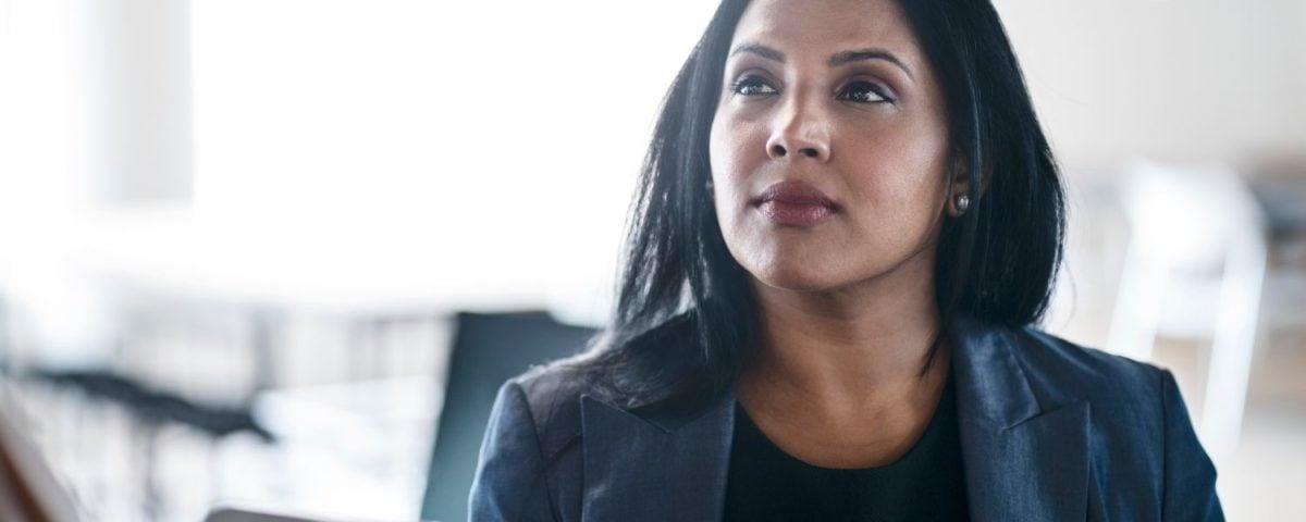 Business woman black jacket thoughtful
