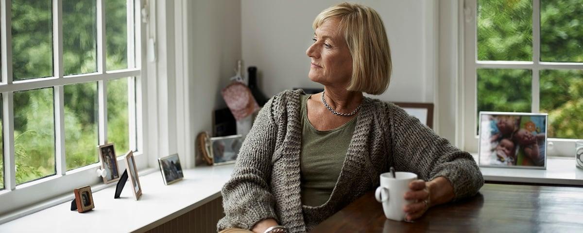 Thoughtful senior woman having coffee