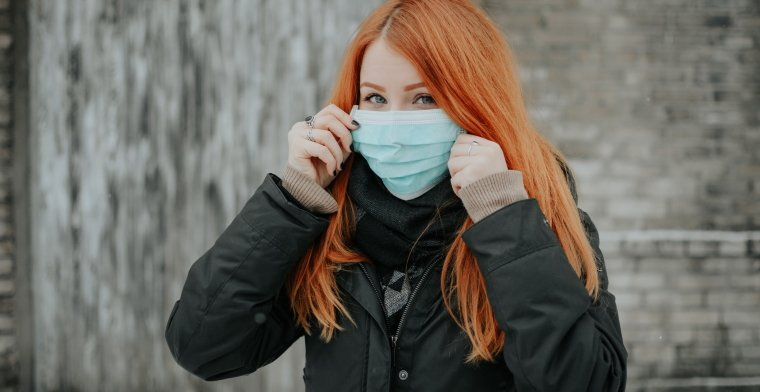 Woman with red hair face mask by pille-riin-priske-
