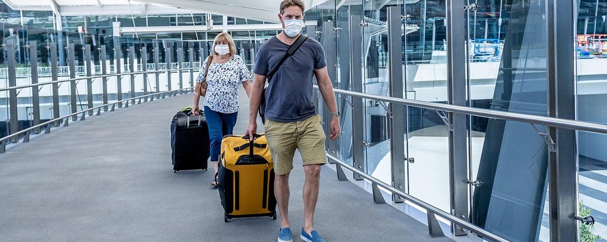 Man and woman walking through airport
