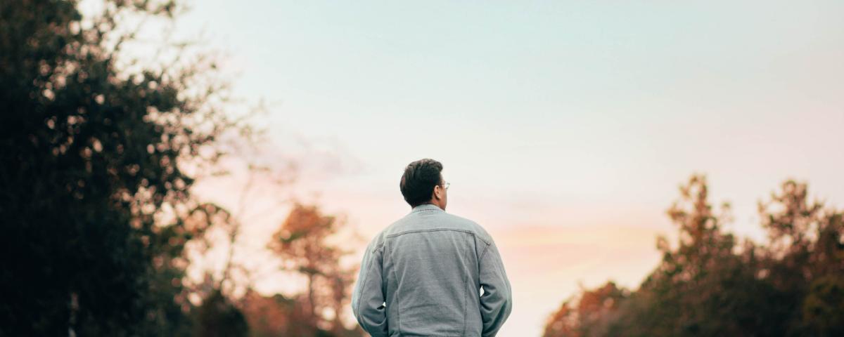 man walking sunset