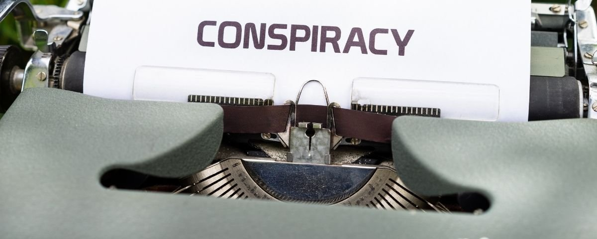 Conspiracy typed out on a typewriter