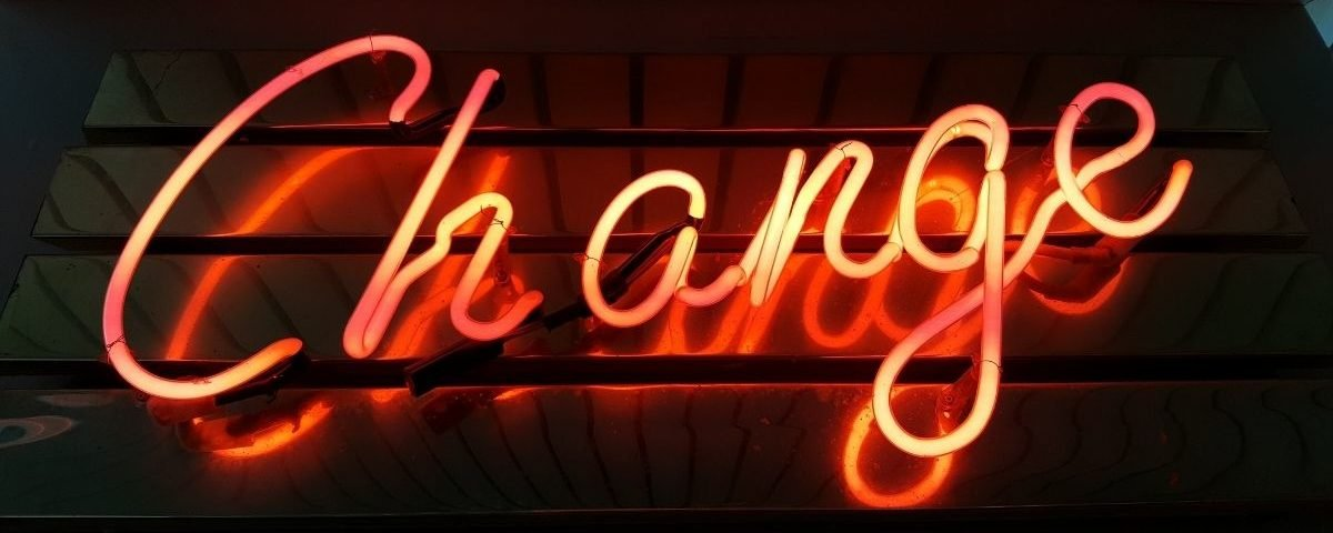 A neon sign with the word Change